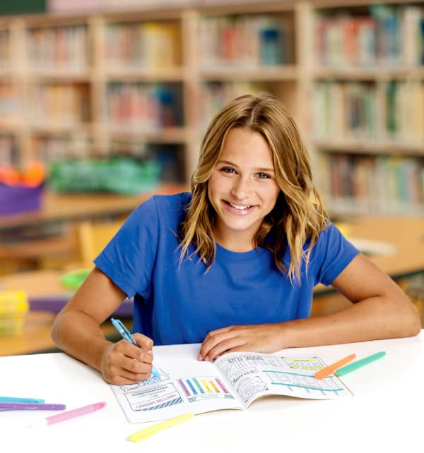 Teenager writing in notebook with Crayola Take Note supplies