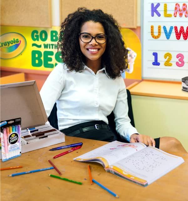 Teacher at desk with Crayola Take Note supplies