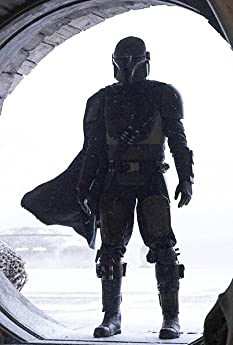 """Remember when 'Star Wars' was just three movies and a bunch of cool toys? Well, the franchise is moving from a galaxy far, far away to a theme park, a VR helmet, and a streaming service near you! On this IMDbrief, let's look at """"The Mandalorian"""" and the Future of the Star Wars Universe."""