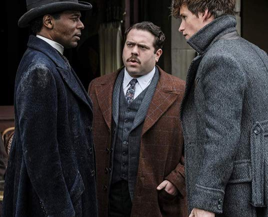 Dan Fogler, William Nadylam, and Eddie Redmayne in Fantastic Beasts: The Crimes of Grindelwald (2018)
