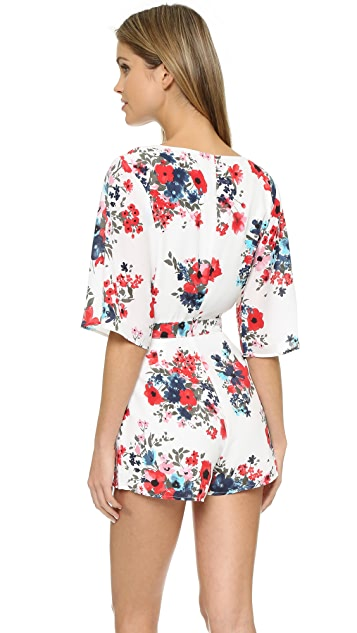 cupcakes and cashmere Kirei Floral Romper