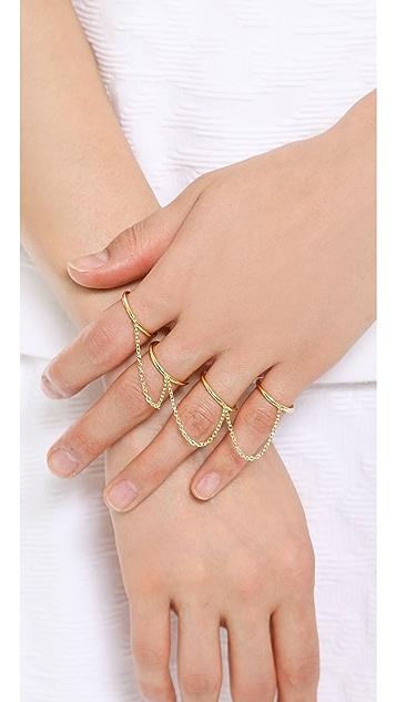 Elizabeth and James Summa 4 Finger Ring