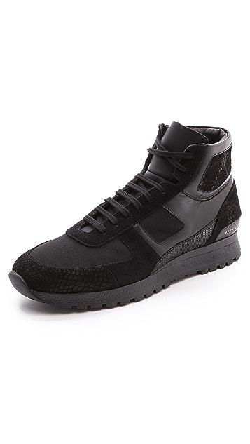6229d572fab352 Robert Geller Robert Geller x Common Projects Track Shoes | EAST DANE