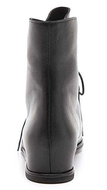 Stuart Weitzman Stepmistress Hidden Wedge Booties