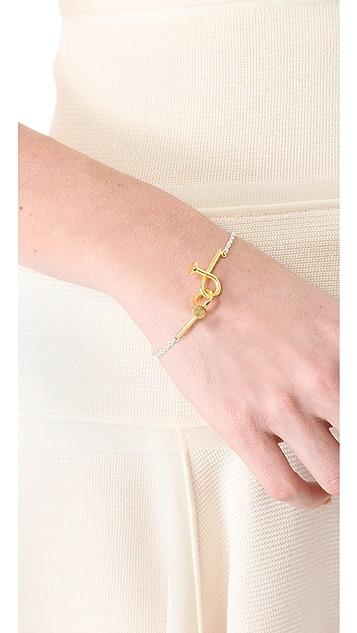TOM BINNS Voila Puzzle Nail Bracelet