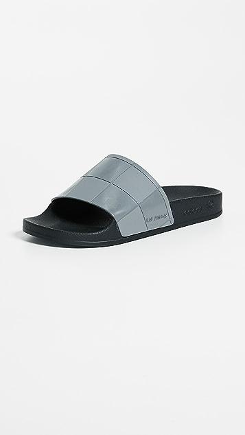 7a51db38058562 adidas Raf Simons Adilette Checkerboard Slides