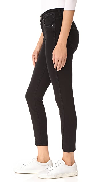 AMO High Rise Twist Jeans