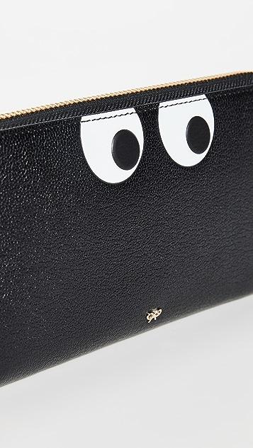 Anya Hindmarch Объемный кошелек с молнией по периметру и изображением глаз