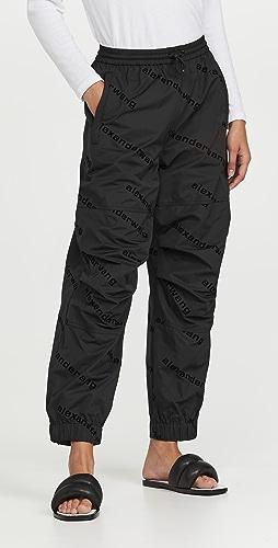 Alexander Wang - Allover Flocked Logo Track Pants