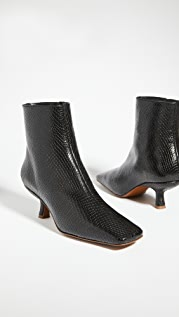 BY FAR Lange Snake Print Booties