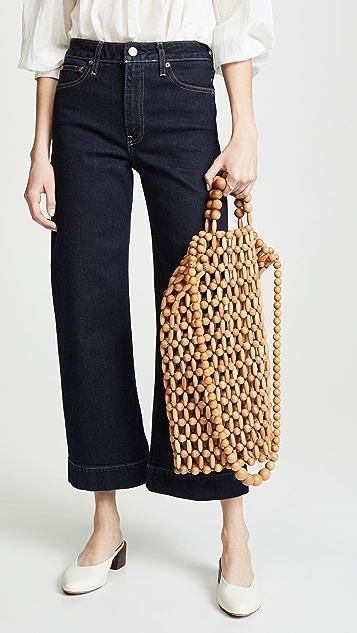 Cult Gaia Объемная сумка с короткими ручками Riya