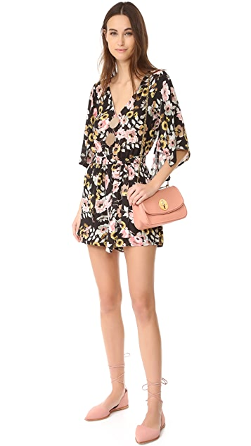 cupcakes and cashmere Emile Everly Floral Romper