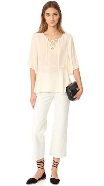 cupcakes and cashmere Jocelyn Lace Up Flutter Blouse
