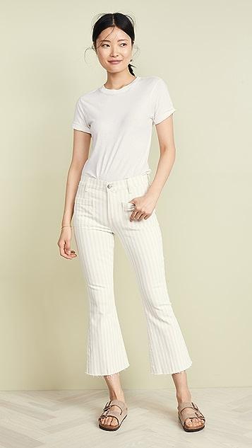 FRAME Укороченные расклешенные джинсы Le Bardot с необработанными краями