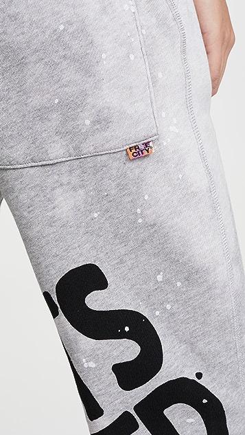 FREECITY Спортивные брюки с карманами, эффектом поношенности и брызгами краски