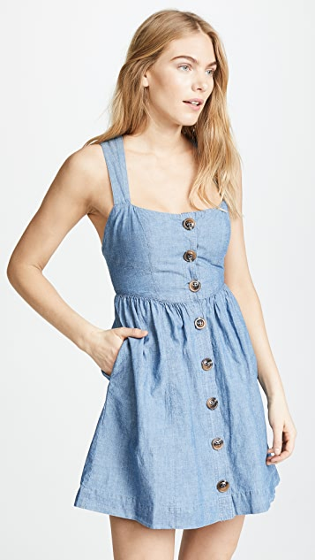 Carolina Chambray Mini Dress in Blue. - size 0 (also in 2,4,6,8) Free People