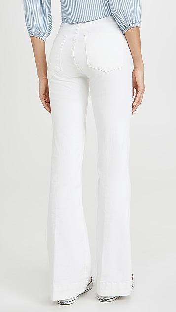 Good American Расклешенные джинсы Good