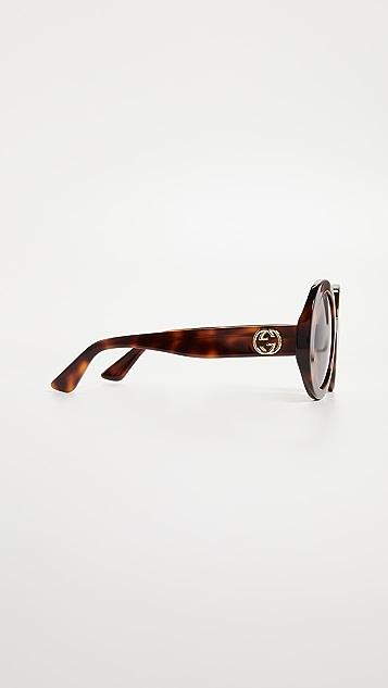 Gucci Овальные солнцезащитные очки GG