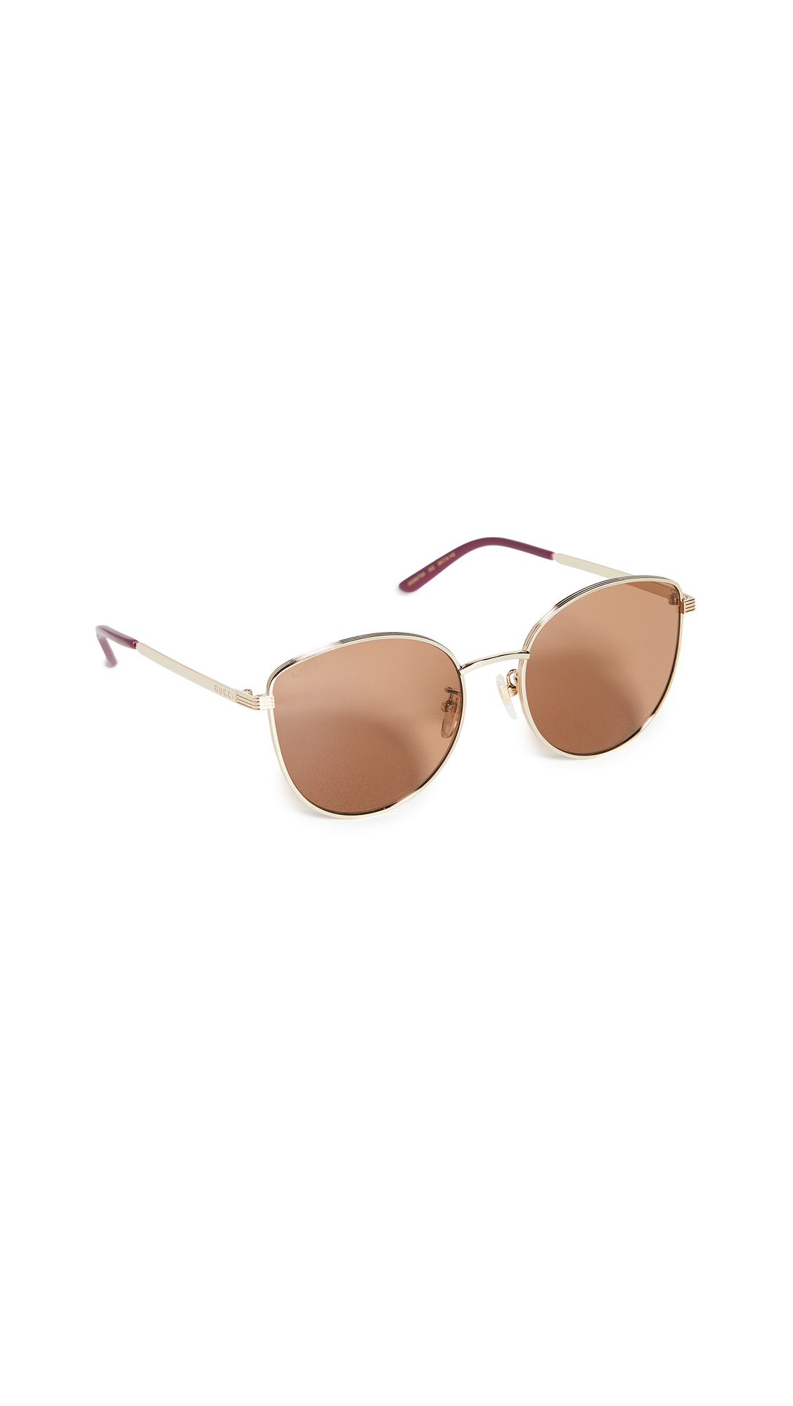 Gucci Light Metal Feminine Cat Eye Sunglasses In Gold Gold Brown