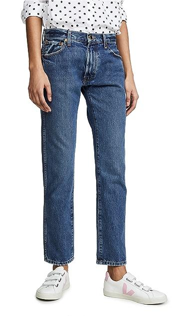 Khaite Свободные джинсы Kyle с низкой посадкой