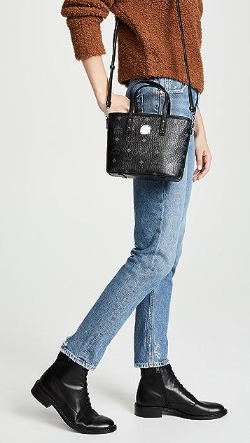 MCM Миниатюрная объемная сумка с короткими ручками Anya с молнией сверху