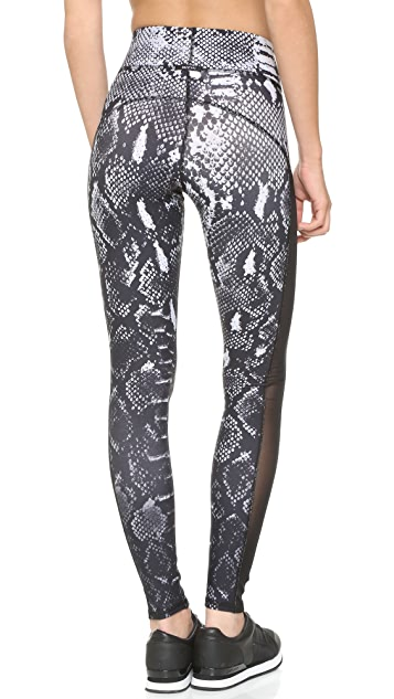 MICHI Stardust Python Print Leggings