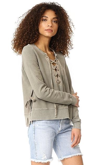 Pam & Gela Side Slit Lace Up Sweatshirt