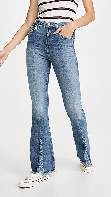 7 For All Mankind Сильно расклешенные джинсы Kick с потрепанным низом