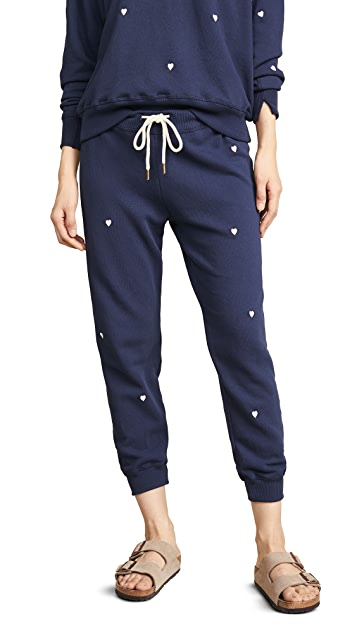 THE GREAT. Cropped Sweatpants with Heart Embroidery