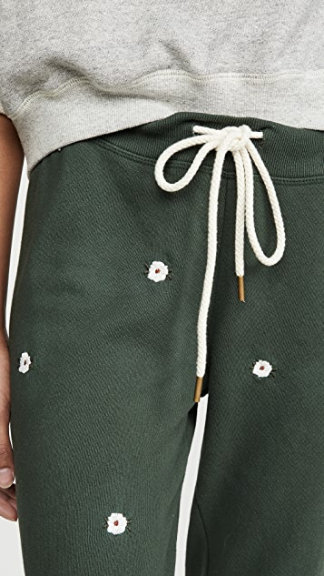 THE GREAT. The Cropped Sweatpants with Wildflower Embroidery