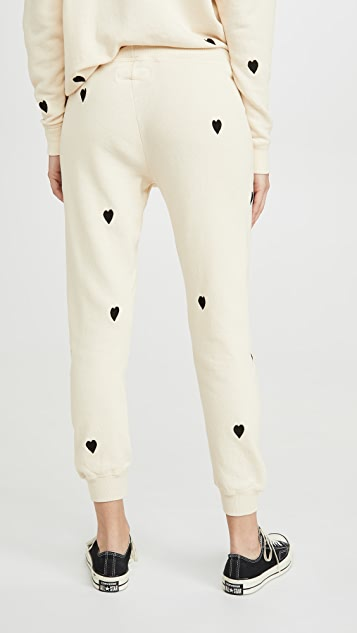 THE GREAT. The Cropped Sweatpants with Heart Embroidery
