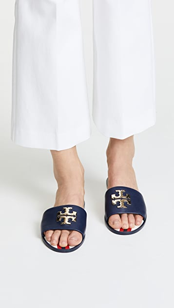 707e55260ac ... Tory Burch Logo Jelly Slides ...