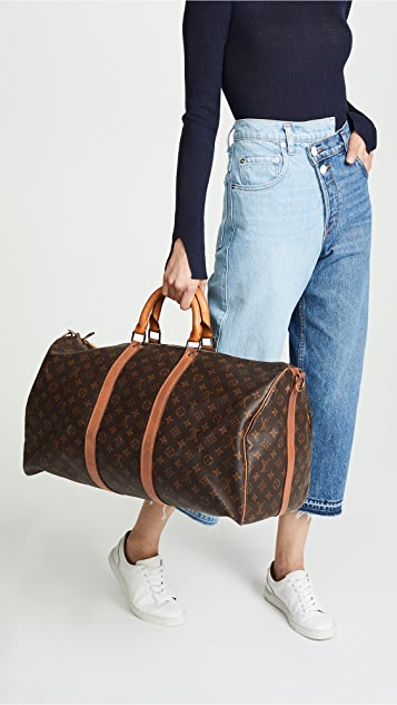 What Goes Around Comes Around Знаковая универсальная сумка Keepall 55 с монограммами от Louis Vuitton