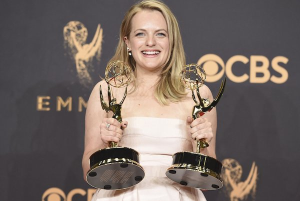 A photo of Elisabeth Moss with her new Emmys.