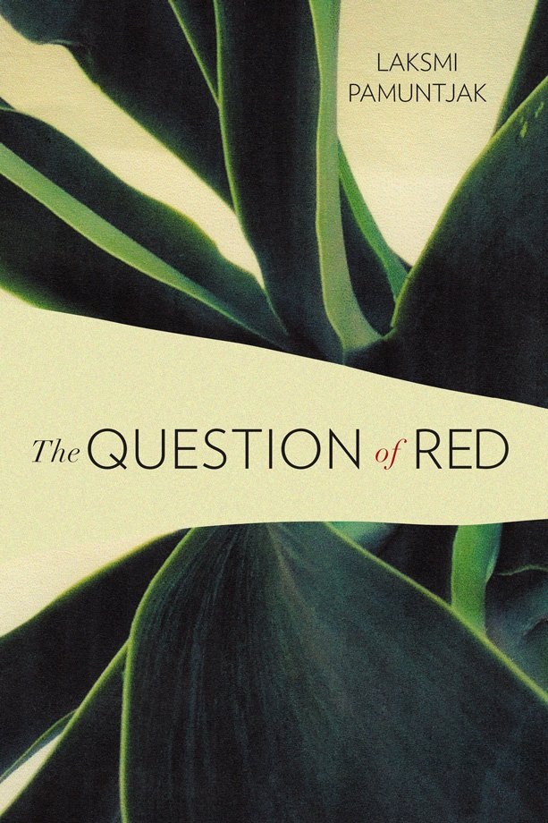 The book cover of The Question of Red by Laksmi Pamuntjak. Translated by the author. The cover shows a close-up image of a tropical, leafy plant on a khaki background that intrudes on the foreground, obscuring the plant and allowing room for the title.
