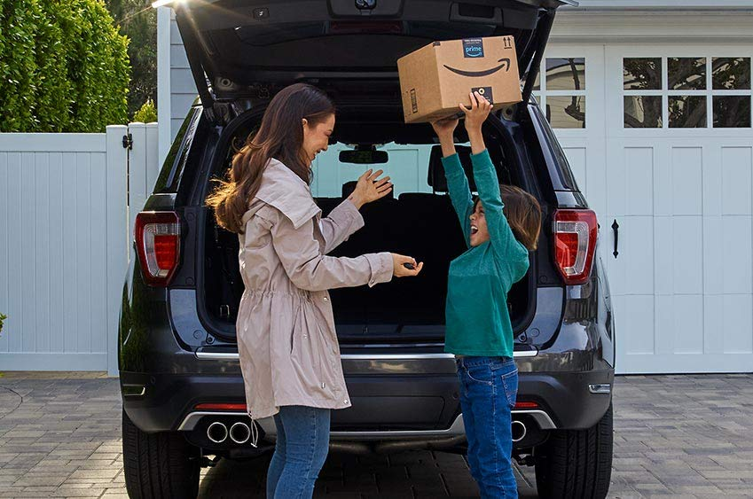Amazon Key Vehicle Eligibility Checker - Image of woman and child with package excitedly receiving in-car delivery