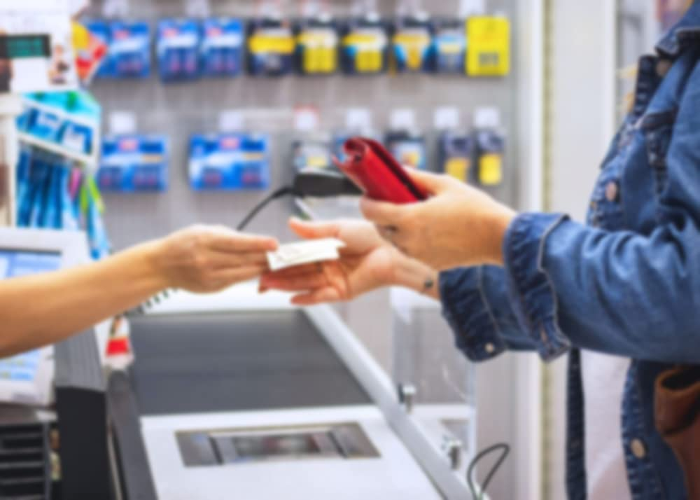 While at a retail store, a clerk gives change to a customer.