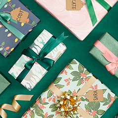 Wrapped holiday gifts with name tags