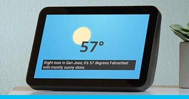 On a nightstand, an Echo Show displays the temperature with Alexa's response captioned.