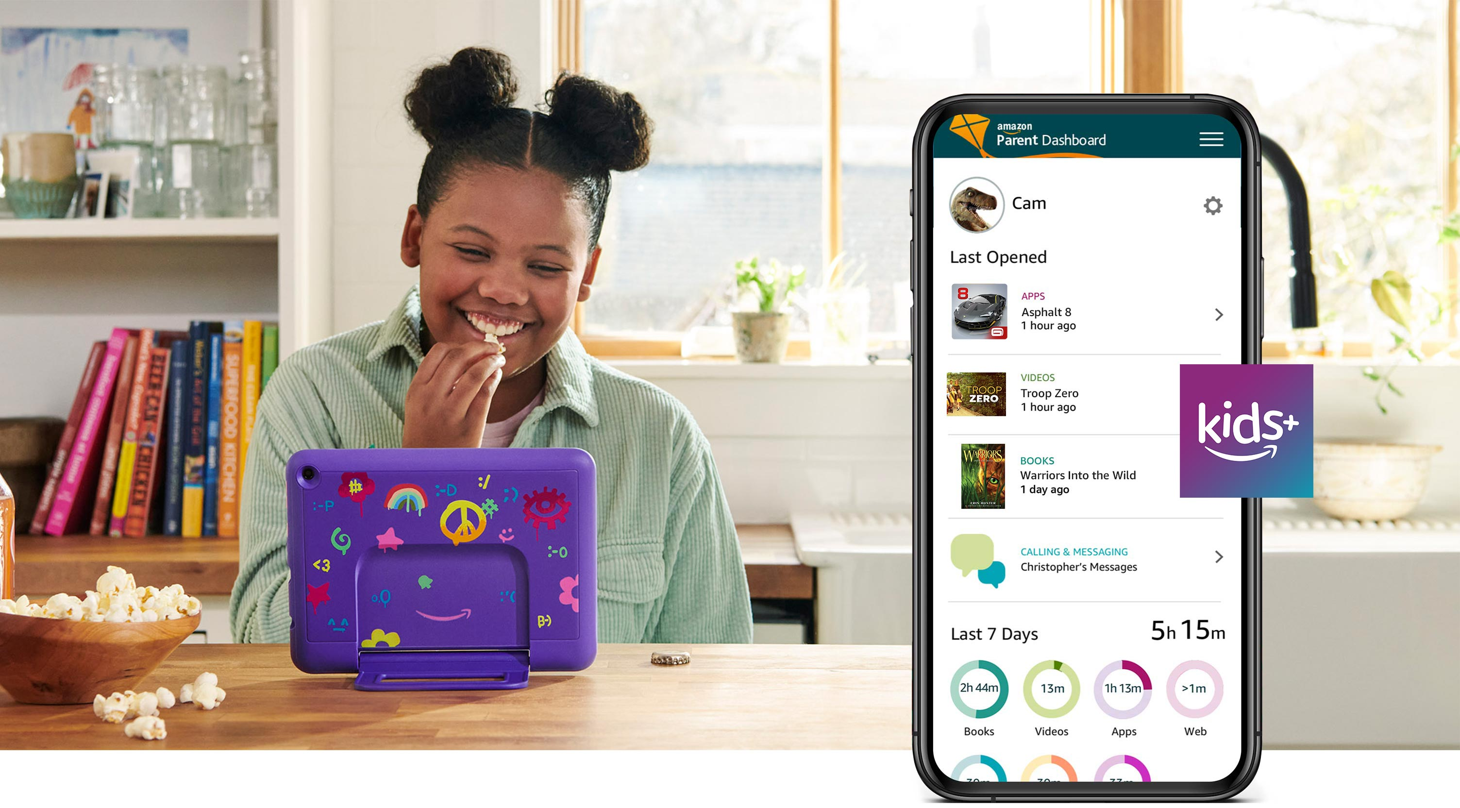Female child using Fire HD 8 Kids Pro while seated at kitchen table, eating popcorn and smiling.