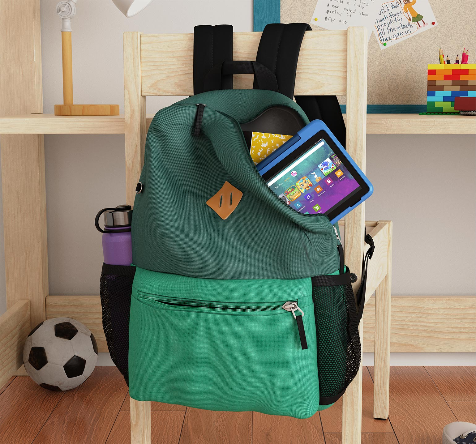 Fire HD 8 Kids Pro tablet about to fall out of child's backpack hanging off back of chair.