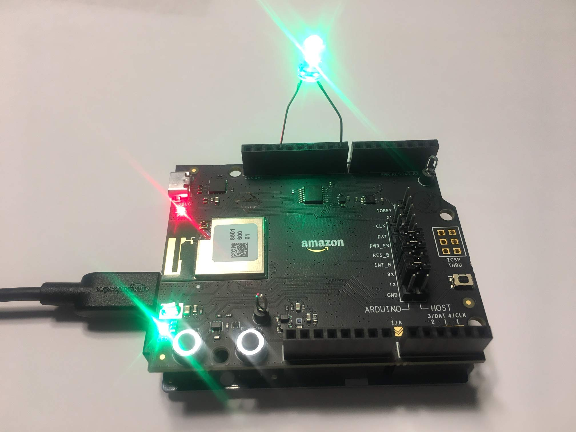 Development Board and Arduino Zero connected, with LED light on