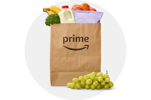 Image of Amazon paper grocery bag with grocery items peaking out of the top and grey circle background