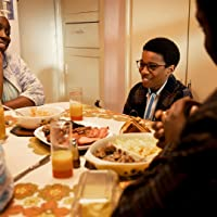 Young Kingsley Smith eating with family