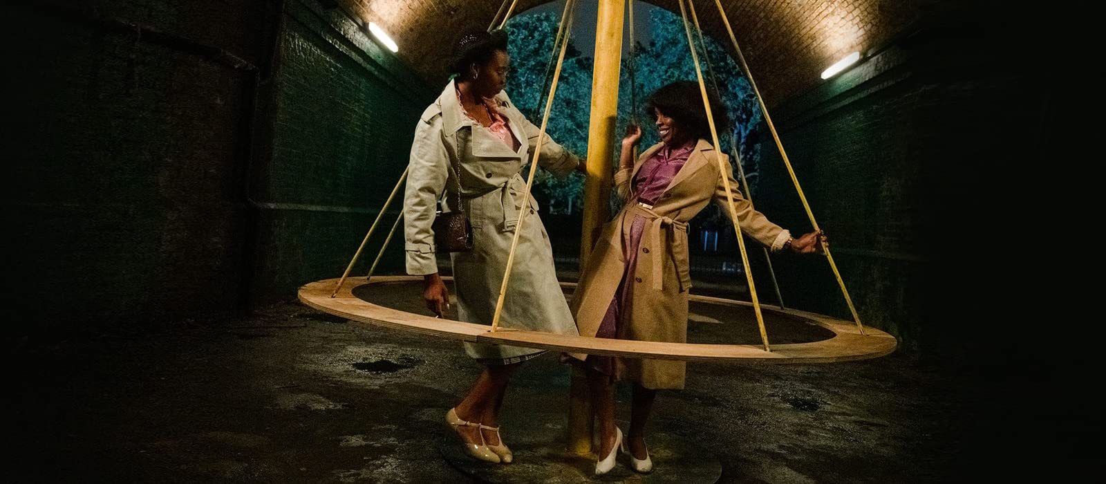 Martha and Patty having fun on swings