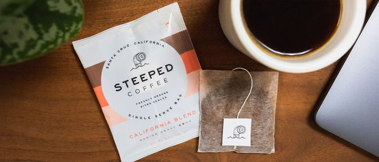 Steeped coffee bag and a cup of coffee