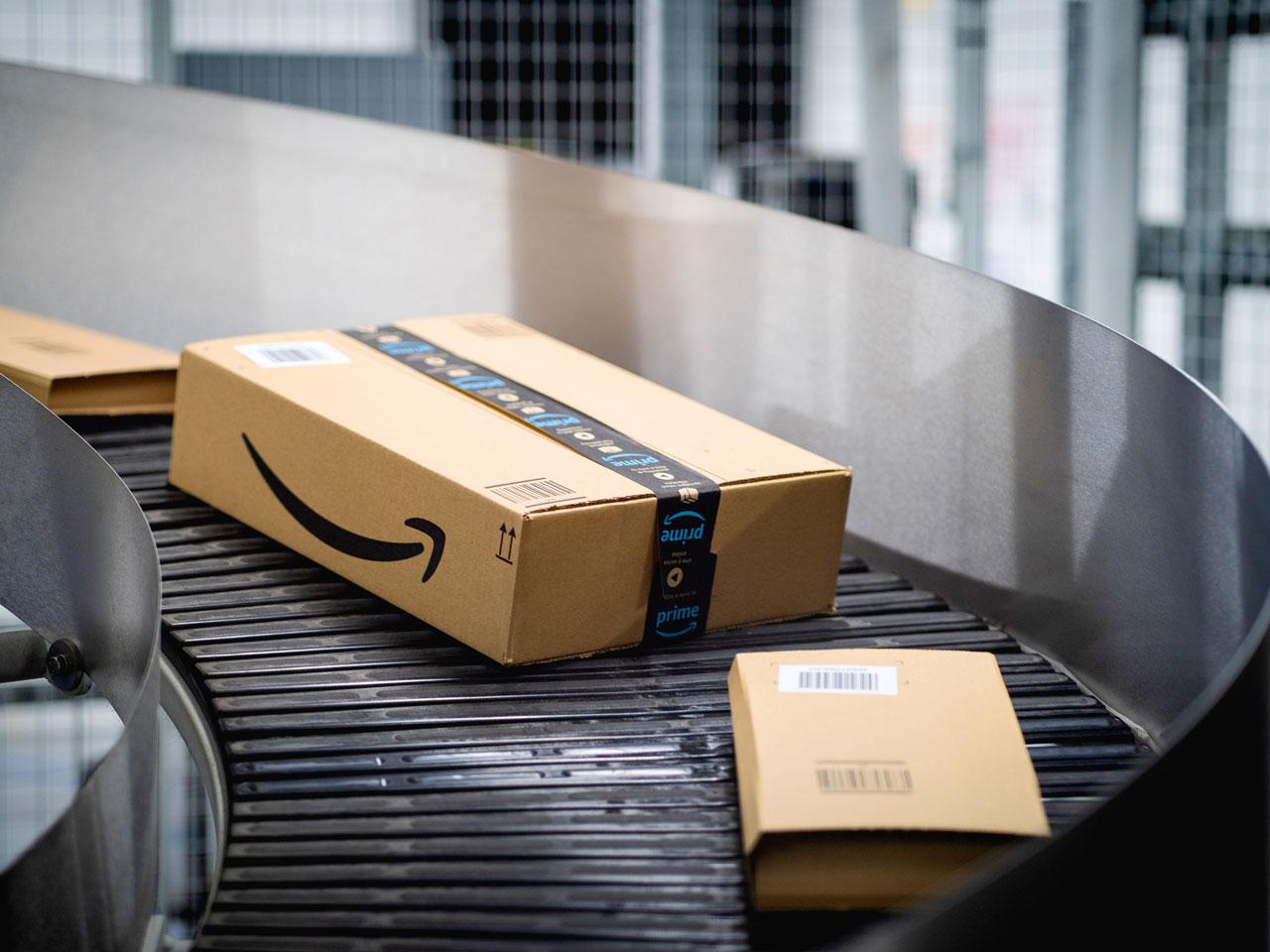 An Amazon box on a conveyor belt