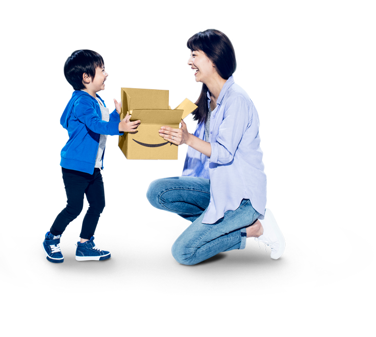 Man and woman holding a stack of Amazon boxes to ship