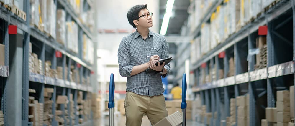 man using a tablet in a warehouse