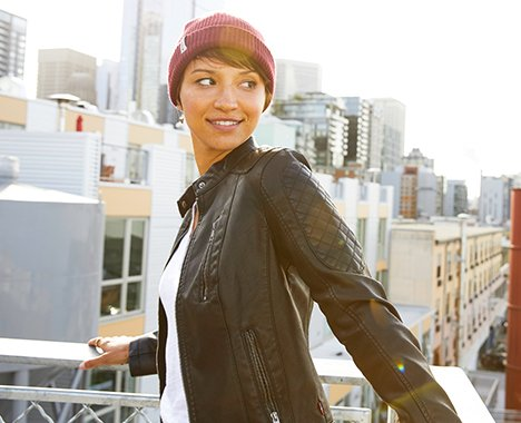 Image of woman wearing a purple beanie.